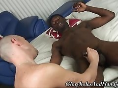 A white gay guy gives a hung black dude an amazing handjob