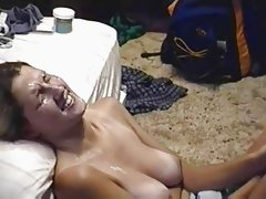 jerking messily onto her face